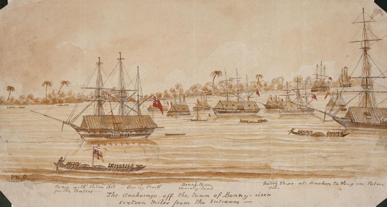 19世纪初的邦尼(Bonny)是如今尼日利亚的棕油河地区主要的贸易港口之一。图中可以看到数艘停靠在镇子岸边的废弃的大船,一些与之交易的小船正靠拢过去。图片版权 ©英国国家海事博物馆